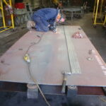 Cutting the new running plate.
